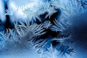 A frozen window covered with frost