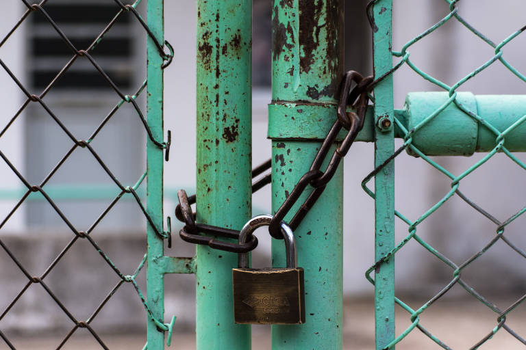 entry secured with padlock